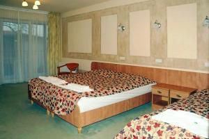 Łóżko lub łóżka w pokoju w obiekcie Rezydencja 5 Dębów