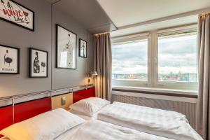 A bed or beds in a room at Radisson Blu Hotel Erfurt