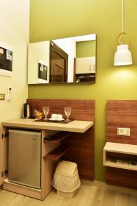 A kitchen or kitchenette at Lafo Rooms