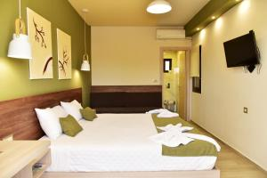 A bed or beds in a room at Lafo Rooms