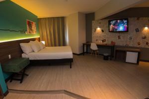 A bed or beds in a room at ibis Styles Sorocaba Santa Rosalia (Ex Chamonix)