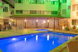The swimming pool at or close to Hotel Costeiro