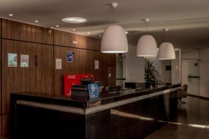 Лобби или стойка регистрации в Fenix Hotel Araxá