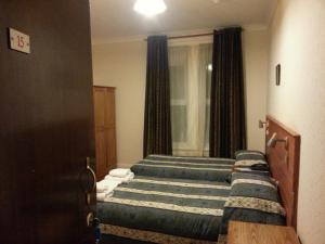 A bed or beds in a room at Channel View Hotel