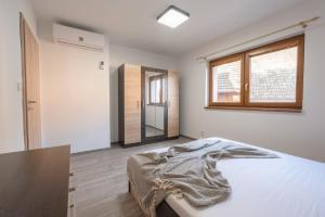 Postel nebo postele na pokoji v ubytování Pohoda Salaš u Velehradu-2 apartmany