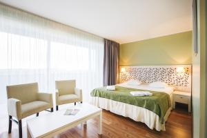 A bed or beds in a room at Hotel Jurmala Spa