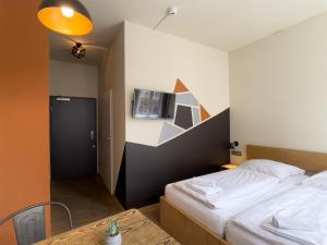 A bed or beds in a room at Five Elements Hostel Leipzig