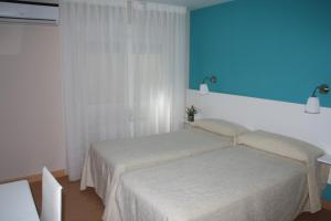 A bed or beds in a room at Verona