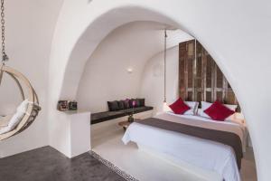 Andronis Boutique Hotel tesisinde bir odada yatak veya yataklar