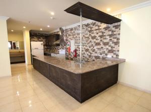 O saguão ou recepção de Al Rabitah Al Fondoqeiah Hotel Apartments