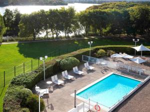 A view of the pool at Novotel Paris Créteil Le Lac or nearby