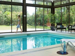 The swimming pool at or near Golf du Médoc Resort Bordeaux - MGallery