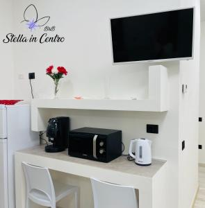 A television and/or entertainment centre at Stella in Centro