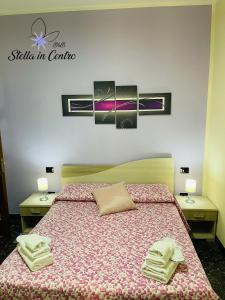 A bed or beds in a room at Stella in Centro