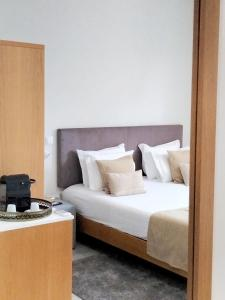 A bed or beds in a room at Souto Guest House