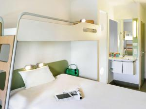 A bed or beds in a room at ibis Budget Paris La Villette 19ème