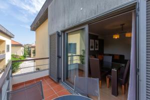 A balcony or terrace at Villaggio Manique Appartment