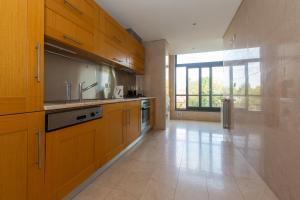 A kitchen or kitchenette at Villaggio Manique Appartment