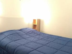 A bed or beds in a room at Appartement Piau-Engaly, 3 pièces, 8 personnes - FR-1-457-204