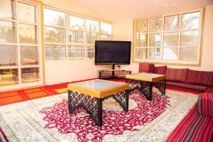A television and/or entertainment center at Farm Al Medfek