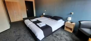 A bed or beds in a room at Herberg Boswijck, B&B