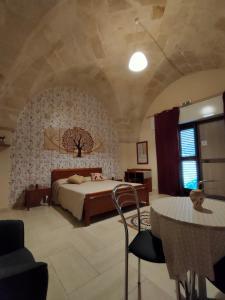 Letto o letti in una camera di Il Sole di Puglia B&B