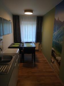 Televízia a/alebo spoločenská miestnosť v ubytovaní Apartmán Tobias, Vysoké Tatry