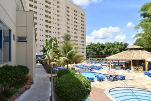 The swimming pool at or near Golden dolphin grand hotel