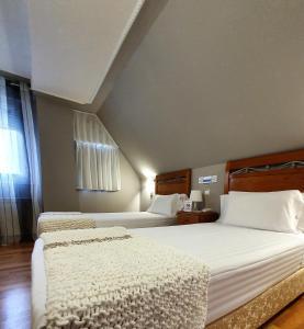 Cama o camas de una habitación en Hotel La Cuesta