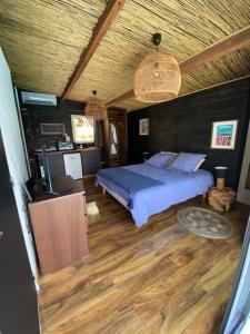 Un ou plusieurs lits dans un hébergement de l'établissement Bastide de la joie de vivre