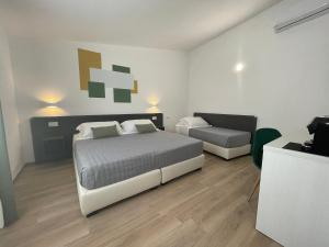 A bed or beds in a room at Admayora Guest House