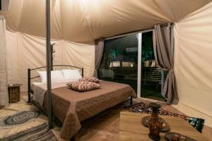 Ένα ή περισσότερα κρεβάτια σε δωμάτιο στο Sueno Luxury Bungalows