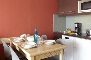 A kitchen or kitchenette at Aparthotel Adagio Marseille Prado Plage