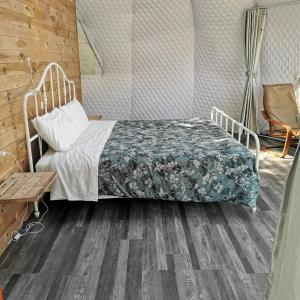 A bed or beds in a room at Blue Bayou Resort, Cape Breton