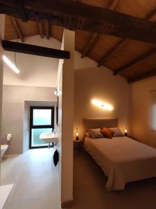 A bed or beds in a room at Casa Carmina Hostel