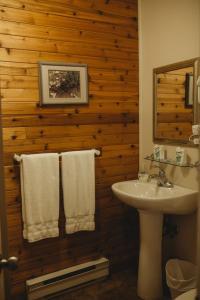 A bathroom at Carriage House Inn Four and a Half Stars