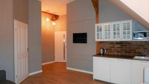 A kitchen or kitchenette at Vintageapartment
