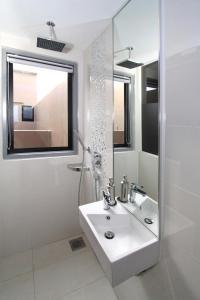 A bathroom at Arton Boutique Hotel (SG Clean)