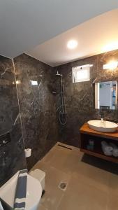 A bathroom at Naiades Almiros River Hotel