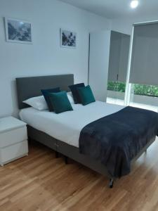 A bed or beds in a room at Chatham Waters