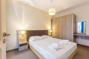 Кровать или кровати в номере Tarsis Club - All Inclusive