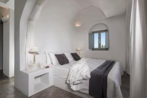 Vuode tai vuoteita majoituspaikassa Andronis Luxury Suites