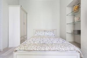 Кровать или кровати в номере Комфортные апартаменты