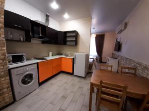 Кухня или мини-кухня в Апарт Отель