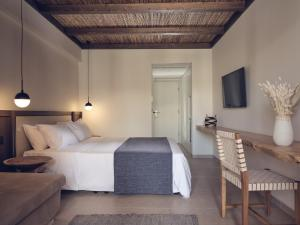 A bed or beds in a room at Zante Maris Hotel & Spa Adults Only