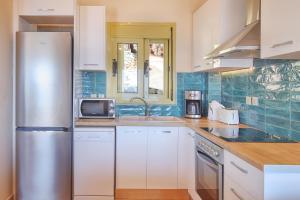 Cucina o angolo cottura di Astra Villas