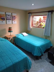 A bed or beds in a room at Pochy's house