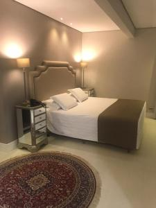 A bed or beds in a room at Hotel Marimar The Place