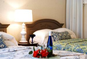 A bed or beds in a room at Summers Inn Ludington - Adults Only