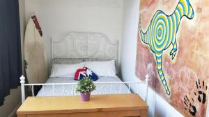 A bed or beds in a room at Pod Bed Coogee Beachside
